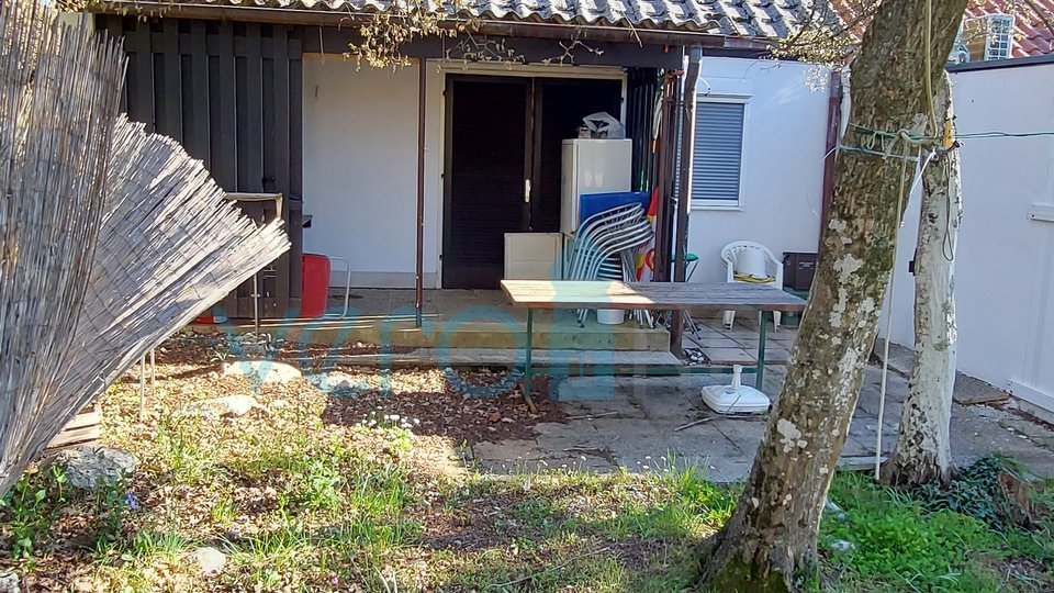 Njivice, island of Krk, cottage in a row with garden