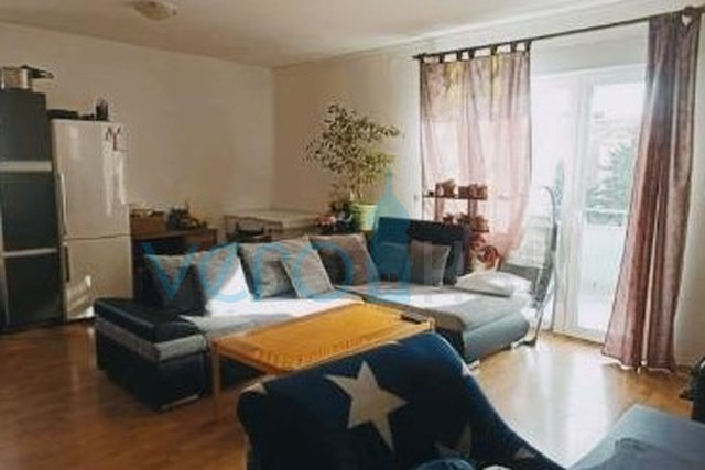 The town of Krk, two bedroom apartment on the second floor with a gallery and garden